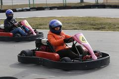 GOMEL, BELARUS - MARCH 8, 2010: Amateur competitions in races on karting trac - stock photo