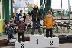 GOMEL, BELARUS - MARCH 8, 2010: Amateur competitions in races on karting trac Stock Photos