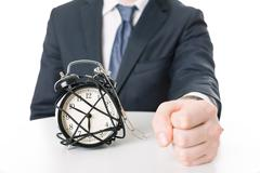 Angry imprisoned man and time pressure - stock photo