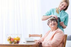 Caregive take care of patient - stock photo