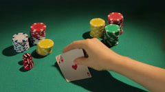 Beginning gambler lucky to win poker game with pair of aces, taking first gain Stock Footage