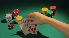 Lucky gambler showing down royal flush hand, poker player wins bank in casino Stock Footage