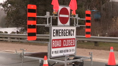 Emergency road closed sign on highway Stock Footage