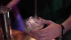 Bartender making a cocktail at the bar Stock Footage