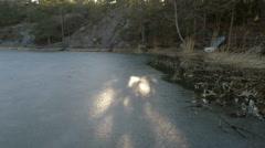 Sunlight on frozen Swedish sea inlet, Stockholm archipelago Stock Footage