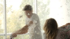 Pillow fight, feathers - stock footage