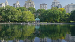 Wide shot of buildings and urban park / New York, New York, United States Stock Footage