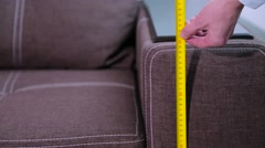 Man measures the dimensions of the furniture Stock Footage