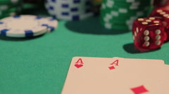 Close-up shot of two aces on poker table, defocused chips on background, casino - stock footage