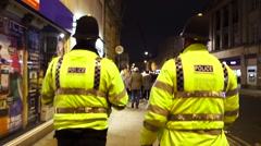 Police Walking UK Hard Hats Stock Footage