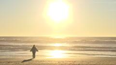 Woman Enjoying Warm Breeze At The Beach - stock footage