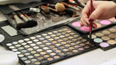 Make-Up Artist Doing Make-Up. on the Table is a Different Cosmetics: Shadows, Stock Footage