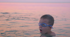 Boy Diving and Splashing in Sea Water Stock Footage