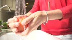 Slow Motion Woman Washing a Vegetable Stock Footage