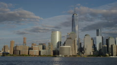 Wide shot of city skyline and waterfront / New York, New York, United States Stock Footage