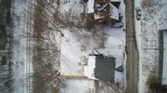 Tracking over the old Neighborhood in the winter snow Stock Footage