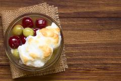 Stewed Gooseberry Dessert with Meringue - stock photo