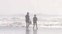Couple Cooling Down On Humid Day At Beach Stock Footage