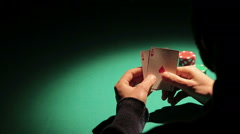 Person dealing cards during poker match, successful player catching good hand Stock Footage