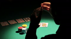Male obsessed with gambling losing all money in poker game, man in despair Stock Footage