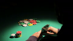 Male gambling addict playing poker at illegal casino, taking risk to lose money Stock Footage