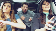 Two beautiful women and one man having fun dancing driving car 4K - stock footage