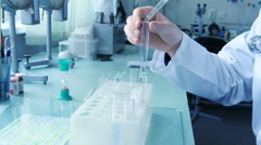 Close up of male hand of doctor scientist fill a test tube of liquid - stock footage