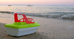 Plastic Toy Ship by the Sea Waves Stock Footage