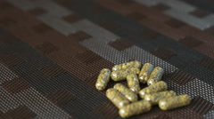 Hand finds pills in the form of capsule on a table Stock Footage