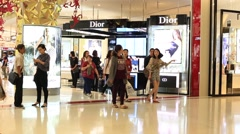 People walking near the Dior store in Siam Paragon Mall. Bangkok, Thailand - stock footage