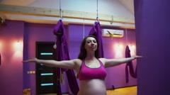 Pregnant woman meditating at yoga center Stock Footage