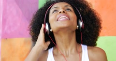 Brazilian afro woman listing to music on colorful background - stock footage