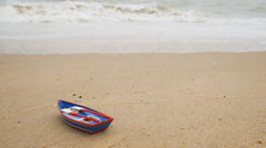 Toy boat on the beach in summer season - stock footage