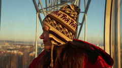 Beutiful young woman smiling from height in the ferris wheel - stock footage