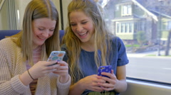 Teens Play On Their Smartphones, While Riding A Train, They Take Silly Selfies Stock Footage