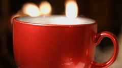 Warm mug of hot coffee by the fireplace Stock Footage