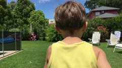 Young boy running. Captured with steady cam gimbal. Back shot of a kid running Stock Footage