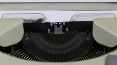 Inserting a blank sheet into a Typewriter - stock footage