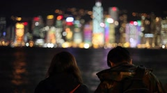 Tourists observing hong kong cityscape at night time. Stock Footage