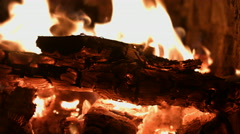 Wood burn in the fire in the fireplace a bright flame. 4k - stock footage
