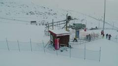 Flying over ski lift on winter resort Stock Footage
