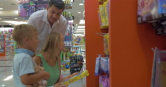 In search of a learning game in the shop - stock footage