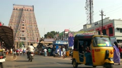 Tiruchirappalli - Street view with people and traffic in front of temple. Stock Footage