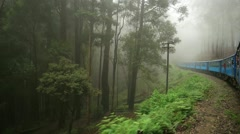 Sri Lanka - Slow motion ride by highland train. Fog in forest. Stock Footage