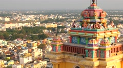 Hindu temple tower detail with city view and pigeons. Rock Fort Temple. 4K Stock Footage