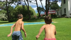 Children running and jumping to the swimming pool water. Kids sprinting to pool Stock Footage