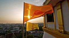Thai Buddhist flag at sunset . Dharmacakra flag, Stock Footage