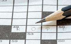 Pencil on the Crossword puzzle Stock Photos