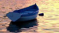 Boat on water of Malta Harbor at sunset time Stock Footage