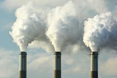 Multiple Coal Fossil Fuel Power Plant Smokestacks Emit Carbon Dioxide Pollution Stock Photos